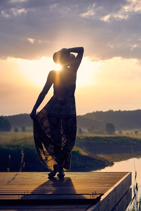 Woman silhouette in sunset
