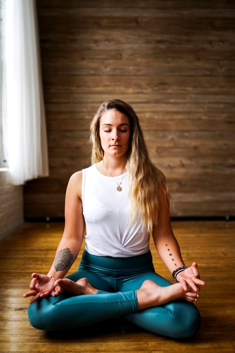 Woman in yoga sitting pose