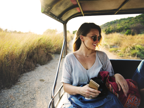 Young woman driving on safari